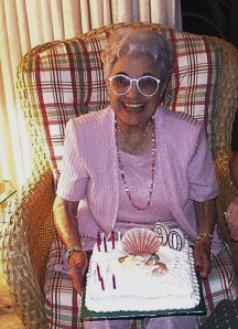 woman smiling with 90th birthday cake