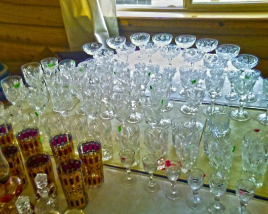 photo with a large number of cut glass pieces on it lined up as they are unpacked