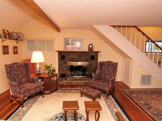 photo of living room with two upholstered wing chairs
