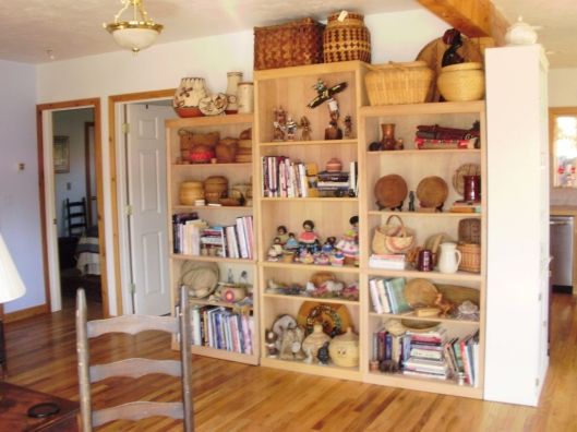 three book shelves with antique items