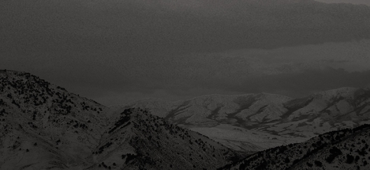 sepia photo of snow covered mountans