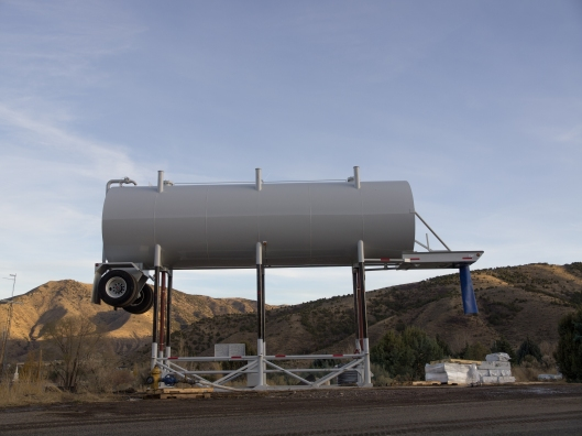large water tanker truck elevated on stilts