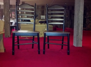 two ladderback chairs with crooked rungs