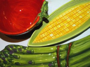 closeup of corn, tomato and asparagas shaped dishes