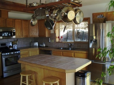 photo of kitchen with french door frig on the right back.