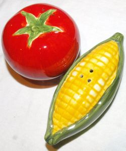 closeup of corn and tomator shaped salt and pepper shakers