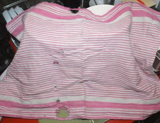 dish towel with holes, faded red and white striped