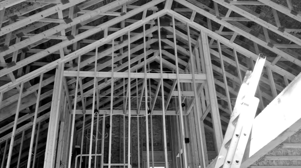 house under construction ceiling structure with ladder on the right