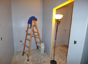 house under construction, ladder in small cubby, lamp between it and the bathroom to be.
