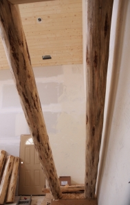 log stair stringers without treds viewed from underneath with high side at the top of the photo