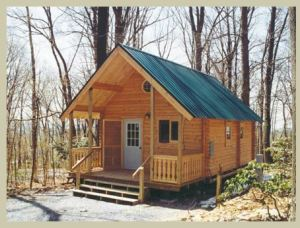 small rectangular log cabin with roof and front porch