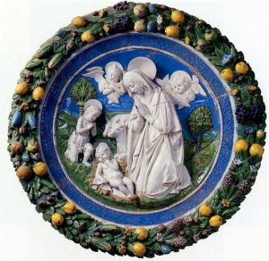 della robbia terracotta polychrome wreath with fruit around the border and a Virgin Mary scene in its center.
