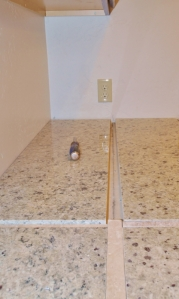 slabe of granite on a countertip with a small cross pattern between the slabs