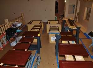 row of saw horses with cabinet doors and drawers and the casegoods boxes all being stained