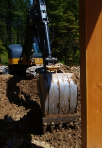 close up of deck post with excavator bucket filling in by the post