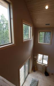 high windows vewed from a loft.
