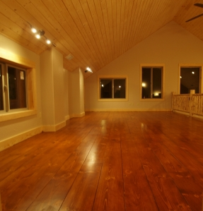 empty room showing newly finished floor which is a deep red brown with a satin finish