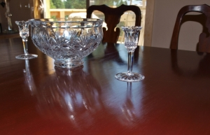 "Some of our ""box-lot"" Waterford crystal glistening on the hand rubbed finish of our flat box table. The chairs are antiques found on ebay. After days of loving care, they are restored to use."